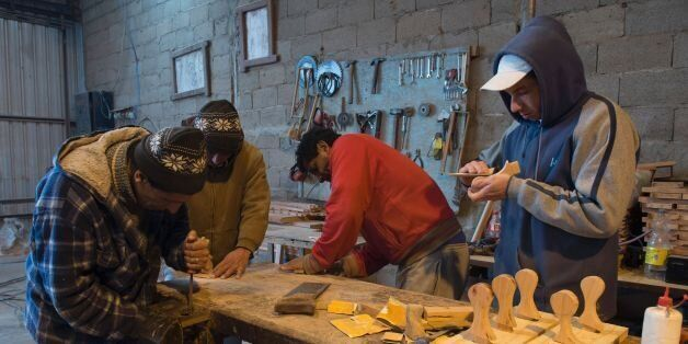 Inmates work in carpentry workshop at the Punta de Rieles prison in Montevideo on June 15, 2016. Punta...