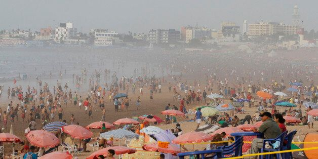 People gather at the beach during a heat wave in Casablanca July 20, 2012, one day before the start of...