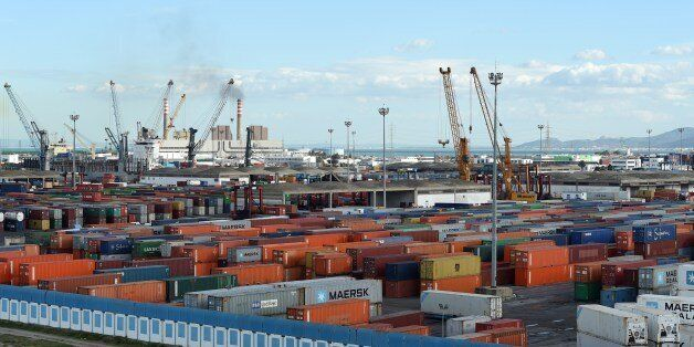 Cranes and containers are pictured on November 12, 2014, in the Tunisian port city of Rades. The World...