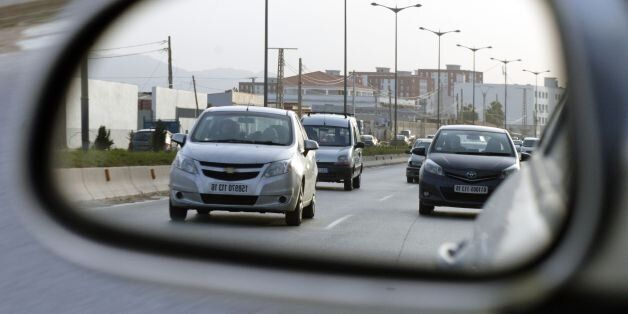 Cars drive on a road in the Algerian capital Algiers on February 1, 2017. / AFP / STRINGER (Photo credit...