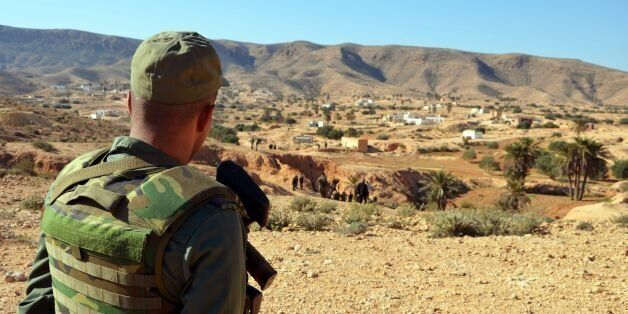 A member of the Tunisian security forces takes part in a security sweep in the mountainous Tounine area,...