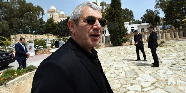 French actor Michel Boujenah visits the archaeological site of Carthage, north of Tunis, on April 18,...
