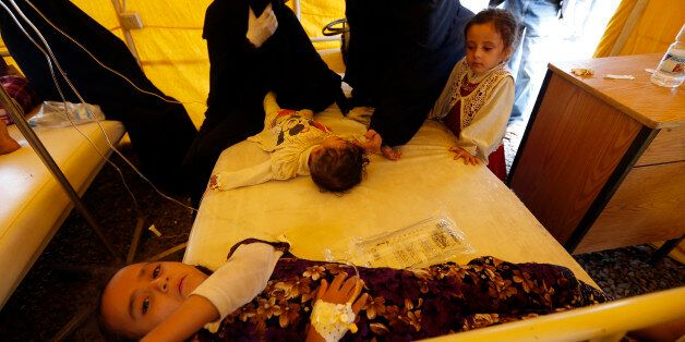 Yemeni children suspected of being infected with cholera receive treatment at Sabaeen Hospital in Sanaa,...
