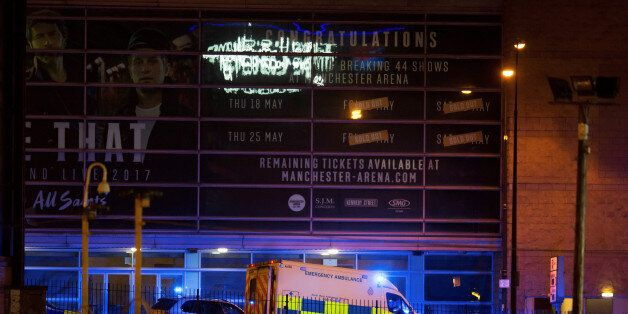 A police van and an ambulance are seen outside the Manchester Arena, where U.S. singer Ariana Grande...