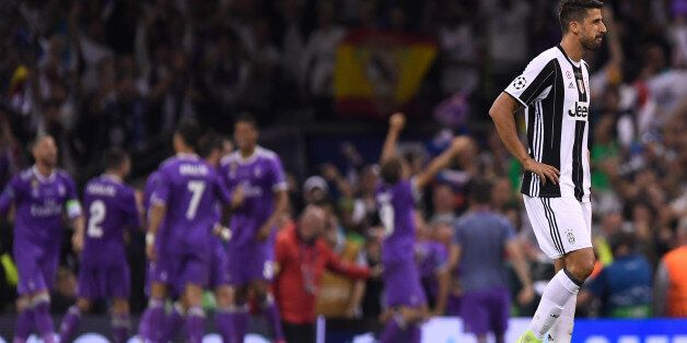 CARDIFF, WALES - JUNE 03: Sami Khedira of Juventus looks dejected after Real Madrid fourth goal during...