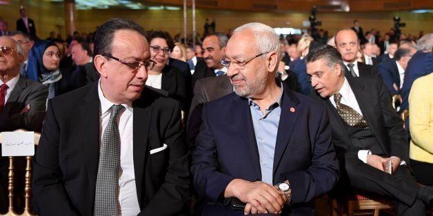 Hafedh Caid Essebsi (L), leader of Nidaa Tounes party, talks with Tunisian Islamist Ennahdha party leader...