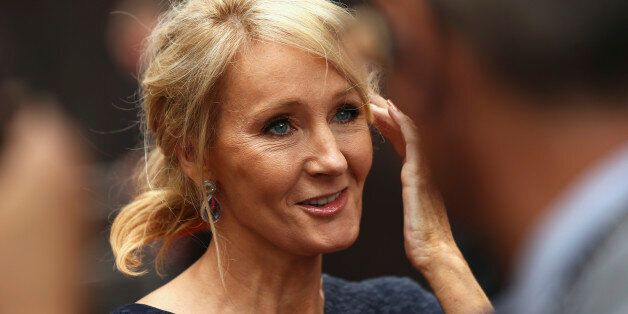 Author J.K. Rowling speaks to media as she arrives at a gala performance of the play Harry Potter and...