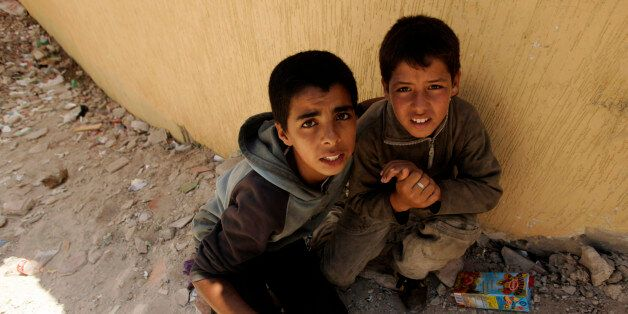 Two homeless children hide from the police near the port in Tangier, July 11, 2007. Approximately two...