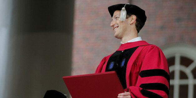 Facebook founder Mark Zuckerberg holds his honorary Doctor of Laws degree during the 366th Commencement...