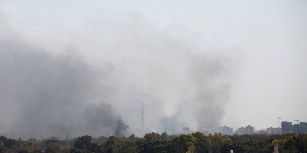 TRIPOLI, LIBYA - MAY 26: Smoke rises after clashes between National Reconciliation Government of Libya...