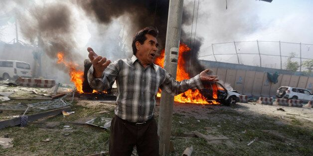 An Afghan man reacts at the site of a blast in Kabul, Afghanistan May 31, 2017.REUTERS/Omar Sobhani TPX...