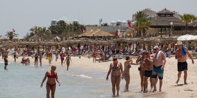 SOUSSE, TUNISIA - JUNE 25: Tourists enjoy the beach on June 25, 2016 in Sousse, Tunisia. Before the 2011...