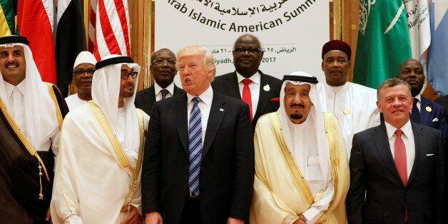 (Front R-L) Jordan's King Abdullah II, Saudi Arabia's King Salman bin Abdulaziz Al Saud, U.S. President...