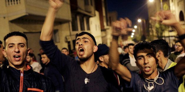 Moroccans shout slogans during a demonstration against official abuses and corruption in the town of...