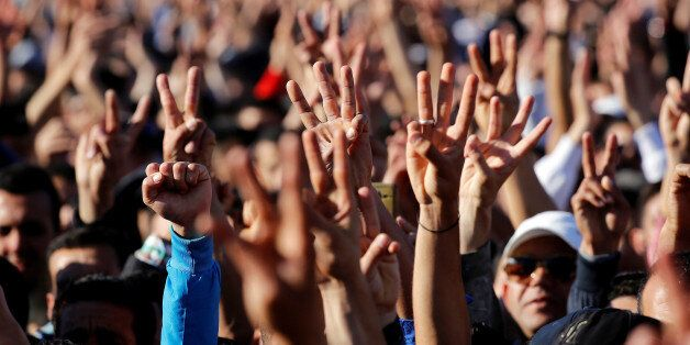 Thousands of Moroccans shout slogans during a demonstration in the northern town of Al-Hoceima, seven...