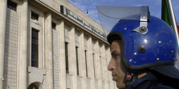 An Algerian policeman stands guard outside the People's National Assembly bulding in the capital Algiers...