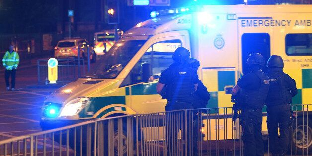 Armed police stand guard at the scene of a suspected terrorist attack during a pop concert by US star...