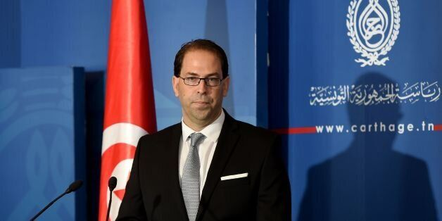 Tunisia's newly appointed prime minister-delegate Youssef Chahed speaks to the press after being appointed...