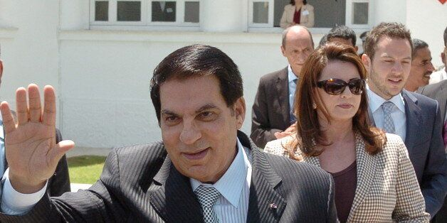 Tunisian President Zine El Abidine Ben Ali (front) waves to wellwishers after voting for the municipal...