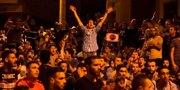 Protesters from Rif movement shout slogans during a demonstration against the government in Al Hoceima...