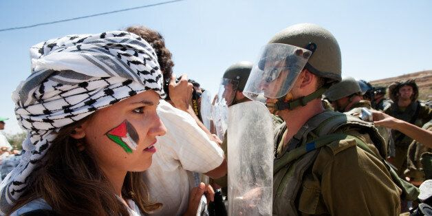 Al-Masara, Occupied Palestinian Territories - August 24, 2012: Italian solidarity activists join Palestinians...