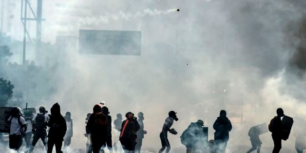 Anti-government protesters block the Francisco Fajardo highway in Caracas during a demonstration against...