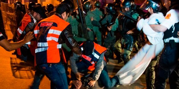Moroccan police clash with protestors during a demonstration against corruption, repression and unemployment...