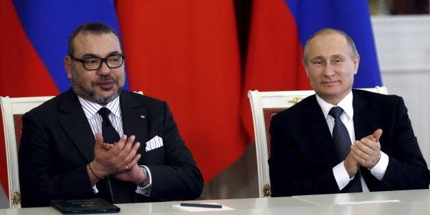 Russia's President Vladimir Putin (R) and Morocco's King Mohammed attend a signing ceremony following...