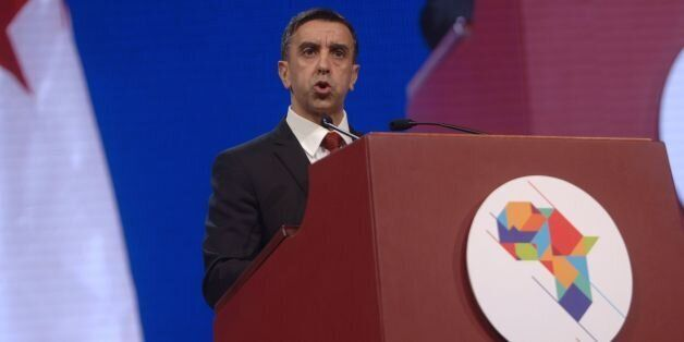 Algerian businessman and president of FCE, Ali Haddad, delivers a speech during the opening ceremony...