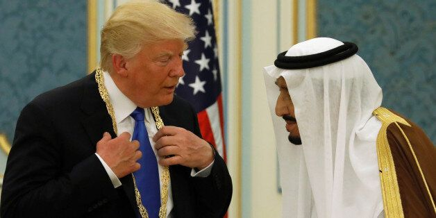 Saudi Arabia's King Salman bin Abdulaziz Al Saud (R) presents U.S. President Donald Trump with the Collar...