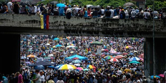 TOPSHOT - Venezuelan opposition activists carry out a protest against the government of President Nicolas...