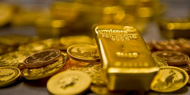 Muenchen, Germany - February 16: Gold bar and Gold Coins in the safe of Pro Aurum Gold trading house...