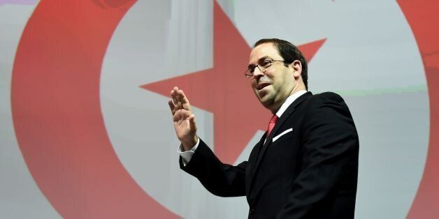 Tunisian Prime Minister Youssef Chahed delivers a speech on the second and last day of the 'Tunisia 2020'...