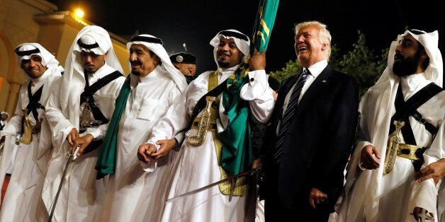 U.S. President Donald Trump dances with a sword as he arrives to a welcome ceremony by Saudi Arabia's...