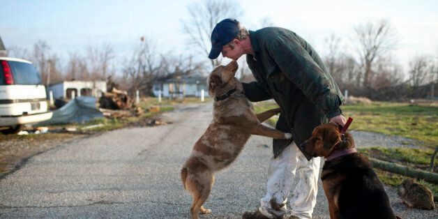 Mike Franke reunites with his dog in Marysville, Indiana March 3, 2012. The latest in a series of powerful...