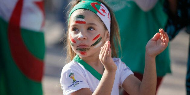 ALGIERS, ALGERIA - JUNE 17: Fans of Algeria watch their national team's soccer match with Belgium during...