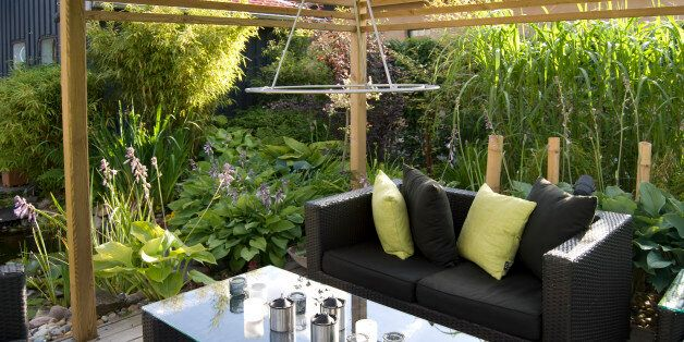 Modern outdoor living, with wicker sofas and