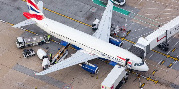 Luggage is loaded onto a passenger aircraft, operated by British Airways, a unit of International Consolidated...