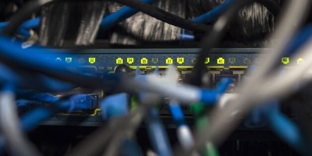 Network cables are seen going into a server in an office building in Washington, DC on May 13, 2017....