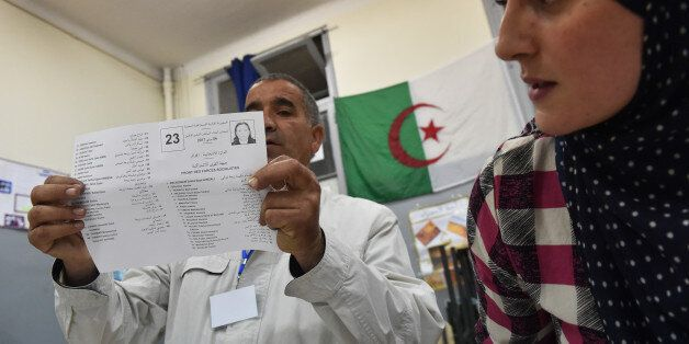 Scrutineers count votes at the end of the Algerian parliamentary elections late on May 4, 2017, in the...