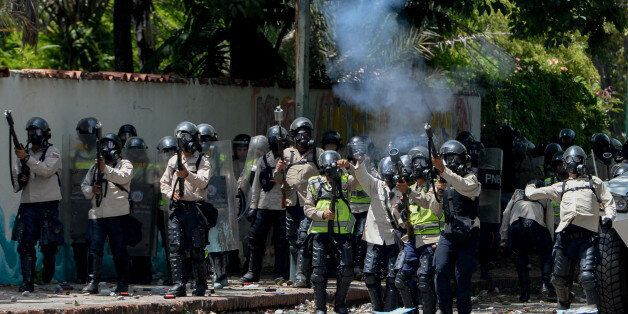 Riot police crack down on students at the Central University of Venezuela during clashes in a protest...