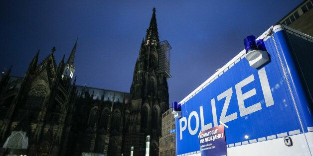 COLOGNE, GERMANY - DECEMBER 31: Police van is seen in front of Cologne Cathedral not far from where on...