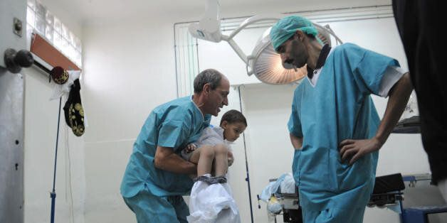 Algerian doctors prepare a boy to be circumcised during a mass circumcision at a local hospital September...