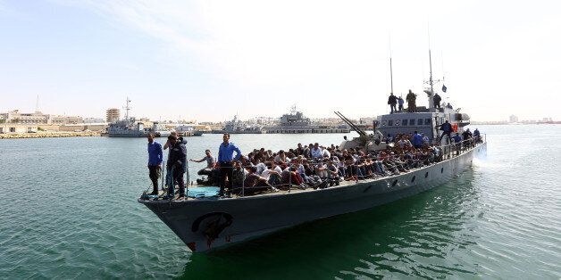 Illegal immigrants, who were rescued by the Libyan coastguard in the Mediterranean off the Libyan coast,...