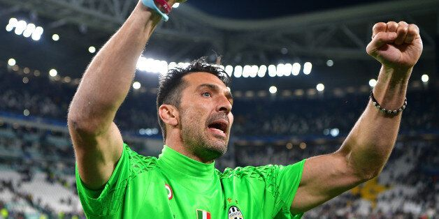 TURIN, ITALY - MAY 09: Gianluigi Buffon of Juventus celebrates as a flyer for the Cardiff final flys...