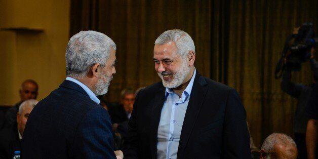 DOHA, QATAR - MAY 1: Deputy Head of Political bureau of Hamas, Ismail Haniyeh (R) shakes hands with Leader...