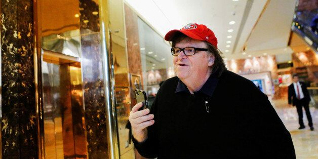 Filmmaker Michael Moore arrives at Republican president-elect Donald Trump's Trump Tower in New York,...