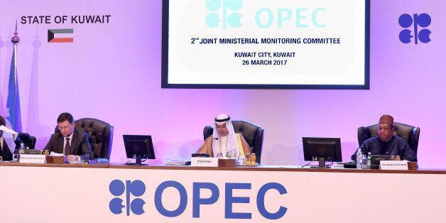 (L to R) Russian Energy Minister Alexander Novak, Kuwait's Oil Minister Essam al-Marzouq and OPEC secretary...