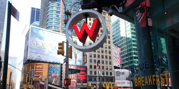 A sign for the W Hotel is shown in New York's Times Square, Thursday, April 29, 2010 in New York. Starwood Hotels & Resorts Worldwide Inc., the owner of the Sheraton, W, Westin and other hotel brands, said hotel demand rose in the first quarter, particularly at its luxury brands, pushing its first-quarter profit sharply higher. (AP Photo/Mark Lennihan)