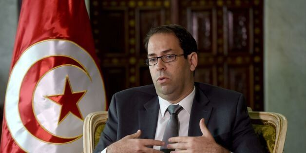 Tunisian Prime Minister Youssef Chahed speaks with AFP journalists on November 8, 2016 in Tunis.The Tunisian...